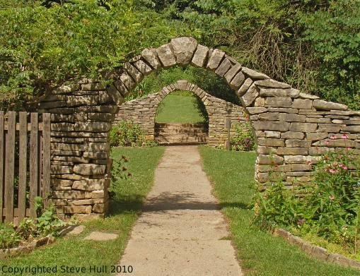Stone arch entrances to the pioneer garden at Spring Mill Village