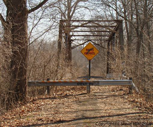 A rusty abandoned iron bridge.