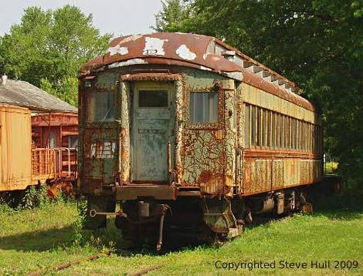 An old railroad car couldn t resist this old car which was sitting